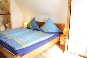 St. Peter-Ording Ferienwohnung Ufer: Foto Schlafraum mit Doppelbett