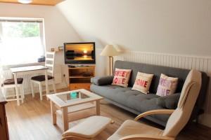St. Peter-Ording Ferienwohnung Ufer: Wohnraumfoto mit Flat-TV