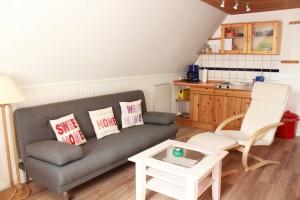 St. Peter-Ording Ferienwohnung Ufer: Foto Wohnraum mit Küche